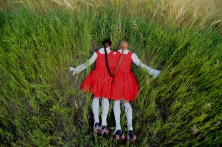 two headed sister lying in ditch facedown